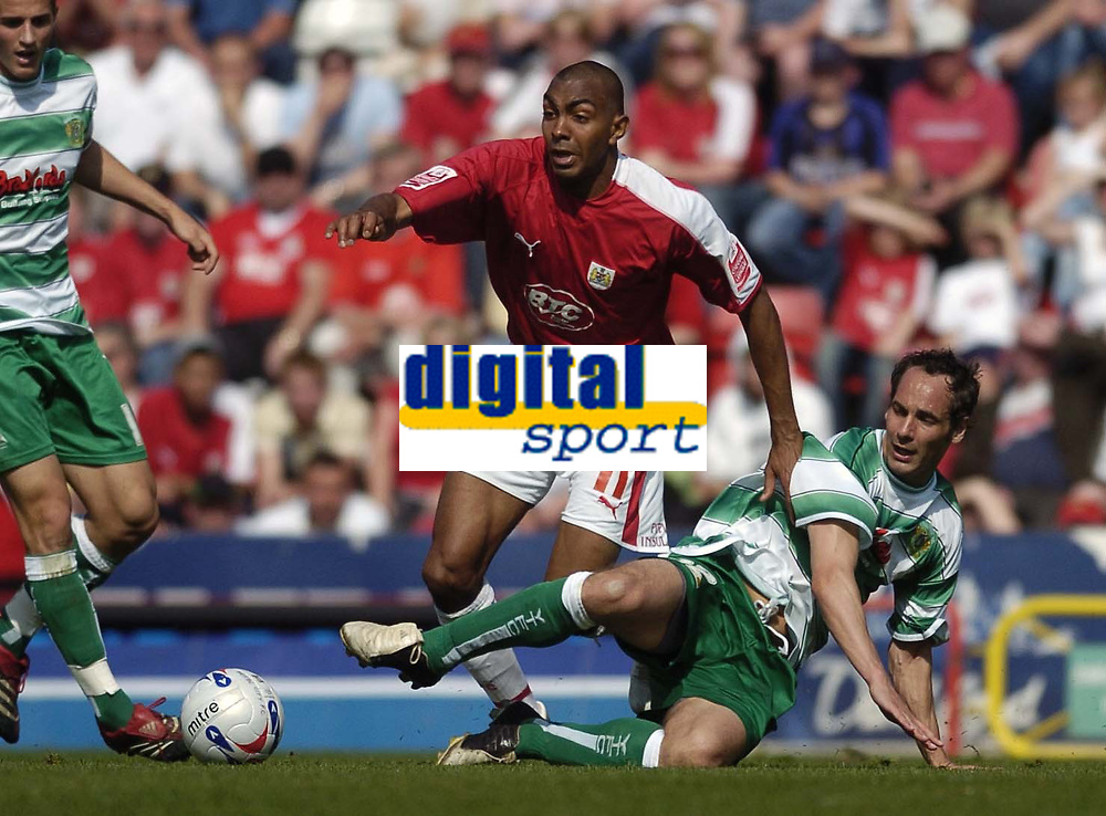 Photo: Jonathan Butler.<br /> Bristol City v Yeovil Town. Coca Cola League 1. 14/04/2007.<br /> Kevin Betsy of Bristol is tackled by Matthew Rose of Yeovil.