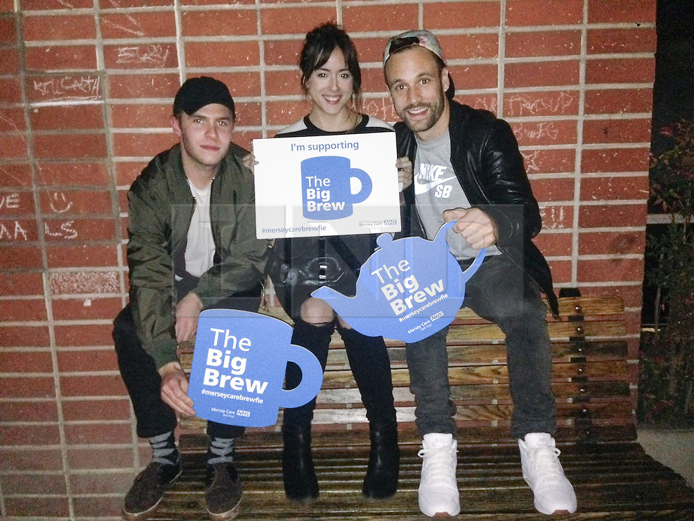 """© Licensed to London News Pictures . 19/01/2015 . Liverpool , UK . Iain De Caestecker , Chloe Bennet and Nick Blood from Agents of Shield . Celebrities pose with """" Big Brew """" placards in support of mental health awareness as today (19th January 2015) marks """" Blue Monday """" , the day regarded by many as the most depressing in the year . Campaigners are urging the public to show support by tweeting sefies with their favourite brew and the hashtag """" #brewfie """" . In London , Deputy Prime Minister Nick Clegg , is announcing his campaign to improve mental health awareness , reduce stigma and promote a """" zero ambition """" target for suicide . Photo credit : Joel Goodman/LNP"""