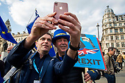 Steve Bray doing a selfie with a fan. Part of the  pro EU demonstrators who have been outside parliament on a daily basis since September 2017 after the country voted to leave the European Union. House of Commons, Westminster, London, United Kingdom