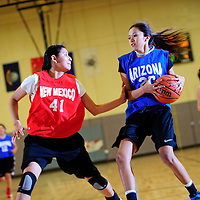 040413       Adron Gardner<br /> <br /> New Mexico All-Star and Santa Fe Indian Brave Danielle Nelson (41), left, shadows Arizona All-Star and Winslow Bulldog Laylane Benslow (20) down court during the girls All-Star game at Miyamura High School in Gallup Thursday.