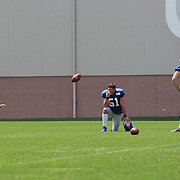 Kicking team Steve Weatherford (left), Zac DeOssie, (centre) and Josh Brown, practicing kicking timing during training during the 2013 New York Giants Training Camp at the Quest Diagnostics Training Centre, East Rutherford, New Jersey, USA. 29th July 2013. Photo Tim Clayton.