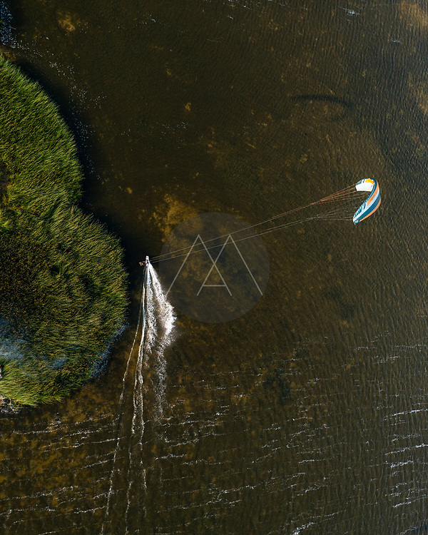 Aerial view of person kitesurfing in Curonian lagoon in Lithuania.
