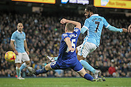 Raheem Sterling (Manchester City) has an attempt on goal, despite Tom Cleverley (Everton) trying to get a block in during the Capital One Cup semi-final match between Manchester City and Everton at the Etihad Stadium, Manchester, England on 27 January 2016. Photo by Mark P Doherty.