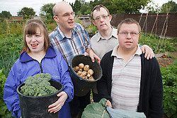 People with learning disability with produce on allotment