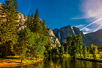 View along the Merced River with Upper Yosemite Fall in background, Yosemite National Park, California USA.