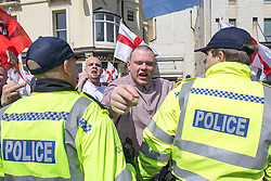 © Licensed to London News Pictures . 21/04/2013 . Brighton , UK . A March for England participant shouts and points at those opposed to him . Nationalist group March for England hold a march along Brighton seafront today (Sunday 21st April) . The group was supported by supporters of the English Defence League and opposed by anti fascist and left wing groups . The annual march takes place close to St George's Day and frequently results in scuffles and violence between opposing groups and police . Photo credit : Joel Goodman/LNP