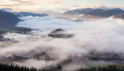 © Licensed to London News Pictures. 07/12/2020. Keswick UK. The town of Keswick in Cumbria can just about be seen through the thick fog this morning as much of the UK has been affected by freezing fog today. Photo credit: Andrew McCaren/LNP