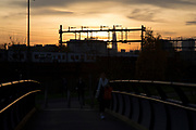 Sunset on a bridge over Regents Canal looking across railway tracks towards The Shard in East London, England, United Kingdom. (photo by Mike Kemp/In Pictures via Getty Images)