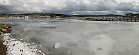 Not the typical February scene on Meredith Bay as it sits without any bob houses due to unsafe ice conditions for the upcoming Rotary Ice Fishing Derby this weekend.   (Karen Bobotas/for the Laconia Daily Sun)