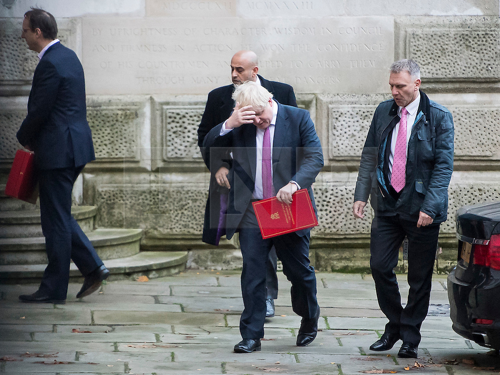 © Licensed to London News Pictures. 23/11/2016. London, UK. Foreign secretary BORIS JOHNSON scratches his head as he arrives on Downing Street in London for a cabinet meeting before Chancellor Philip Hammond delivers his first Autumn statement to parliament. Photo credit: Ben Cawthra/LNP