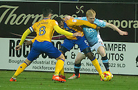Mark Cullen of Blackpool battles with Krystian Pearce and Chris Clements of Mansfield Town<br /> <br /> Photographer James Williamson/CameraSport<br /> <br /> The EFL Sky Bet League Two - Mansfield Town v Blackpool - Tuesday 22nd November 2016 - One Call Stadium - Mansfield<br /> <br /> World Copyright © 2016 CameraSport. All rights reserved. 43 Linden Ave. Countesthorpe. Leicester. England. LE8 5PG - Tel: +44 (0) 116 277 4147 - admin@camerasport.com - www.camerasport.com