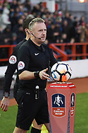 Referee Jonathan Moss collects the ball off the podium during the The FA Cup 3rd round match between Nottingham Forest and Arsenal at the City Ground, Nottingham, England on 7 January 2018. Photo by Jon Hobley.