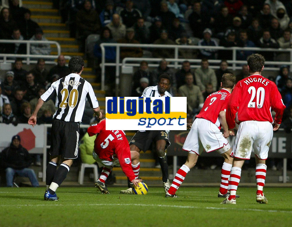 Photo: Andrew Unwin.<br /> Newcastle United v Charlton Athletic. The Barclays Premiership. 22/02/2006.<br /> Newcastle's Shola Ameobi (C) feels the pain following a challenge from Charlton's Chris Perry (#5).