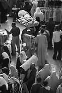 Egypt . Cairo : market in AL Mu'izz LI DIN Allah street under THE GHURIYA, Al Ghuri mosque and khanqa complex  . The Funerary Complex of al-Ghuri, Madrasa, Mosque, Khanqah, Mausoleum and Sabil-Kuttab. Islamic Cairo  Cairo -  NM 189 , 65 66 67