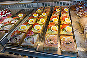 Open face sandwiches at a bakery in Appenzell village, Switzerland, Europe. Bakeries are good places to find a tasty, fresh-made breakfast, lunch, dinner or dessert. Appenzell Innerrhoden is Switzerland's most traditional and smallest-population canton (second smallest by area).
