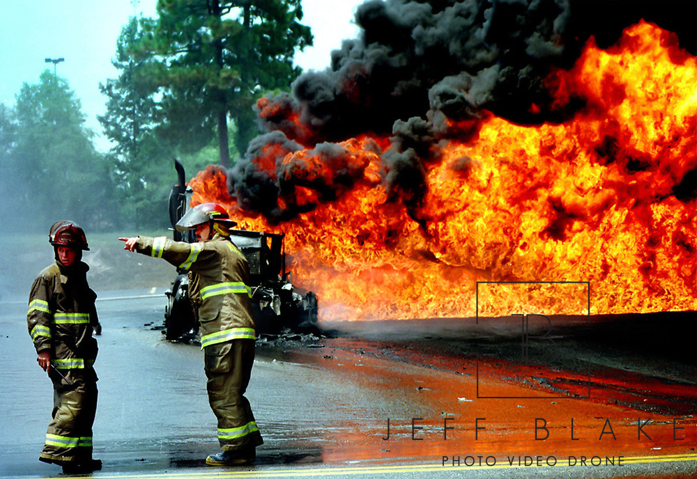 Macon-Bibb firefighters work on putting out a tanker fire Friday afternoon. Photo by Columbia, SC, photojournalist Jeff Blake