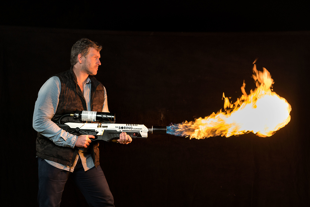 Mike Cernovich with his Boring Company Flame Thrower