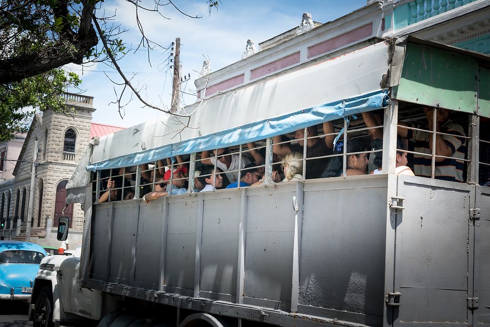 18 September 2015, Cienfuegos, Cuba: People on a truck used for public transport.