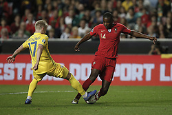 March 22, 2019 - Lisbon, Portugal - William Carvalho of Portugal (R) vies for the ball with Oleksandr Zinchenko (L)  during the Euro 2020 qualifying match football match between Portugal vs Ukraine, in Lisbon, on March 22, 2019. (Credit Image: © Carlos Palma/NurPhoto via ZUMA Press)