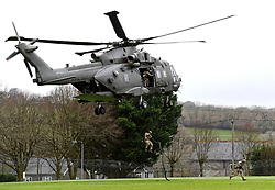 Royal Marines take part in an exercise as the Duke of Sussex visits 42 Commando Royal Marines at their base in Bickleigh.
