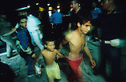 Kosovar Roma Gypsy refugees who came to Italy via Mafia boats from Montenegro after the Kosovo war in 1999. Many died on route and stray Mafia boats drifting where people died of exhaustion or worse, were found in the adriatic and picked up by cargo boats<br /><br /><br />Others lived in the no-mans land during the Bosnia war. They lived for years in UNHCR refugee camps. They are living with racism, prejudice and displacement from their homes. Many came to Italy from the Balkans in search of a new life after the violent disintegration of ex-yugoslavia. Since then they have been forced from their urban camps to live in Container camps outside cities. Brindisi and Bari, southern Italy 1999