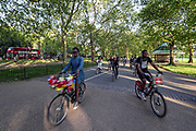 People cycle and jog along Hyde Park in London, Friday, May 15, 2020. Personal exercise while observing social distancing measures is allowed under government lockdown guidelines. However, the United Kingdom might ease the restrictions imposed to halt the spread of coronavirus at different speeds in particular regions, Prime Minister Boris Johnson's spokesman said on Friday. (Photo/ Vudi Xhymshiti)