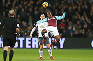 Angelo Ogbonna Obinze of West Ham United heads the ball as Zlatan Ibrahimovic of Manchester United looks on. Premier league match, West Ham Utd v Manchester Utd at the London Stadium, Queen Elizabeth Olympic Park in London on Monday 2nd January 2017.<br /> pic by John Patrick Fletcher, Andrew Orchard sports photography.