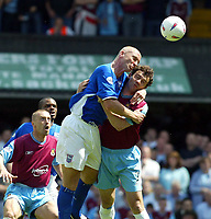 Photo. Chris Ratcliffe, Digitalsport<br /> NORWAY ONLY<br /> <br /> Ipswich Town v West Ham United. Division One Play-off Semi-final. 15/05/2004<br /> Matt Elliott and Christian Dailly tussle for an aerial ball