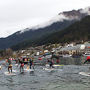 Competitors during the paddle board race during the 'Day on the Bay' events as part of the Queenstown Winter Festival at the Queenstown, South Island, New Zealand, 26th June 2011