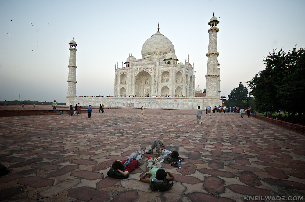 A group of tourists admire The Taj Mahal.  Agra, India