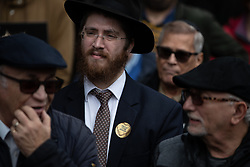 "© Licensed to London News Pictures . 16/09/2018. Manchester, UK. A man wearing a sticker that reads "" Proud to be Jewish "" . Thousands of people including the UK's Chief Rabbi and several Members of Parliament attend a demonstration against rising anti-Semitism in British politics and society , at Cathedral Gardens in Manchester City Centre . Photo credit : Joel Goodman/LNP"