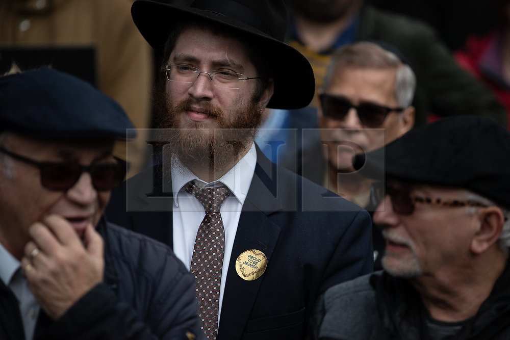 """© Licensed to London News Pictures . 16/09/2018. Manchester, UK. A man wearing a sticker that reads """" Proud to be Jewish """" . Thousands of people including the UK's Chief Rabbi and several Members of Parliament attend a demonstration against rising anti-Semitism in British politics and society , at Cathedral Gardens in Manchester City Centre . Photo credit : Joel Goodman/LNP"""