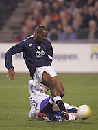 10 February 2006: Eddie Pope (23) of the U.S. beat's Japan's Yuji Nakazawa (22) to the ball and slams it home for the first goal in the 27th minute. The United States Men's National Team led Japan 3-0 early in the second half at the Pac Bell Park in San Francisco, California in an International Friendly soccer match.