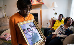 November 20, 2018 - Laporte, IN, USA - Glenda O'Neal, mother of Chicago Mercy Hospital shooting victim Dr. Tamara O'Neal, holds picture of her family the home in LaPorte, Ind., on Tuesday, Nov. 20, 2018. (Credit Image: © Zbigniew Bzdak/Chicago Tribune/TNS via ZUMA Wire)