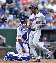 July 2, 2017 - Kansas City, MO, USA - Minnesota Twins' Byron Buxton scores in front of Kansas City Royals catcher Salvador Perez on a single by Brian Dozier in the fifth inning on Sunday, July 2, 2017 at Kauffman Stadium in Kansas City, Mo. (Credit Image: © John Sleezer/TNS via ZUMA Wire)