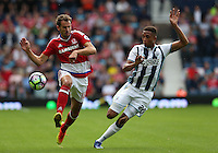 Middlesbrough's Christian Stuani and West Bromwich Albion's Brendan Galloway<br /> <br /> Photographer Stephen White/CameraSport<br /> <br /> The Premier League - West Bromwich Albion v Middlesbrough - Sunday 28 August 2016 - The Hawthorns - West Bromwich<br /> <br /> World Copyright © 2016 CameraSport. All rights reserved. 43 Linden Ave. Countesthorpe. Leicester. England. LE8 5PG - Tel: +44 (0) 116 277 4147 - admin@camerasport.com - www.camerasport.com