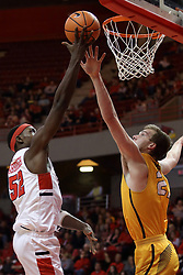 27 January 2018:  Milik Yarbrough lifts the ball to the iron passing the block of Derrik Smits during a College mens basketball game between the Valparaiso Crusaders and Illinois State Redbirds in Redbird Arena, Normal IL