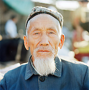 Portrait of an elderly man in traditional clothing in Tianshui, Gansu province, China