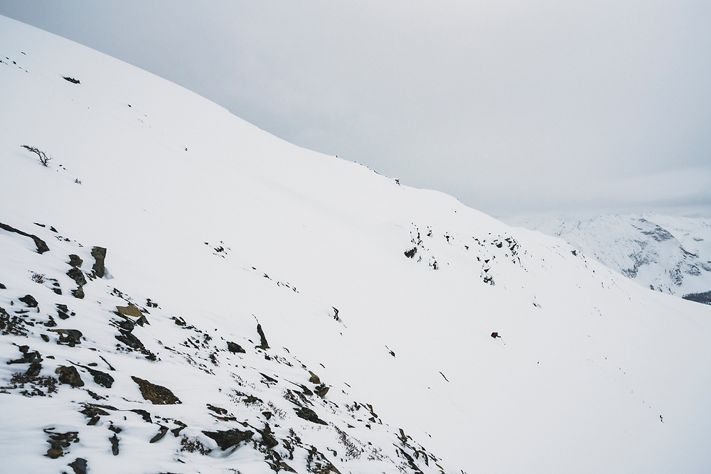 Ali Vagnini skis northwest from the highest point in the Esplanade Range, Cupola Mountain (2632m), British Columbia