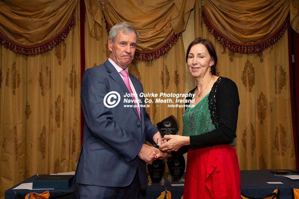 27/10/2019, Bohermeen Athletic Club 50th Anniversary celebration at the Ardboyne Hotel, Navan.<br /> Vincent Rennicks makes a presentation to Mary Parke - Club Record Holder<br /> Photo: David Mullen / www.quirke.ie ©John Quirke Photography, Unit 17, Blackcastle Shopping Cte. Navan. Co. Meath. 046-9079044 / 087-2579454.<br /> ISO: 400; Shutter: 1/200; Aperture: 6.3; <br /> File Size: 2.8MB
