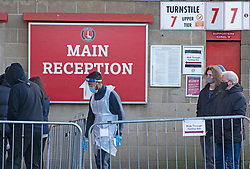 © Licensed to London News Pictures 03/01/2021.        Charlton, UK. A Covid-19 tester in full PPE. A Coronavirus testing centre has been set up by Greenwich Council at Charlton Athletic's football stadium in South East London to rapid test secondary school students and staff. <br /> The rapid test should give results in 30 minutes. Photo credit:Grant Falvey/LNP