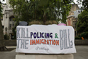 A banner opposing the Police and Immigration Bills is pictured draped on a plinth during a Kill The Bill protest in Parliament Square on 5th July 2021 in London, United Kingdom. The Police, Crime, Sentencing and Courts PCSC Bill 2021, which was being debated in the Houses of Parliament, would grant the police a range of new discretionary powers to shut down protests, including the ability to impose conditions on any protest deemed to be disruptive to the local community, wider stop and search powers and sentences of up to 10 years in prison for damaging memorials.