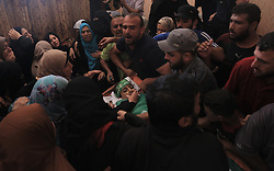 October 6, 2018 - Gaza City, The Gaza Strip, Palestine - Relatives in Gaza city mourners the body of Fares Sersaw a 12 years old Palestinian boy killed by Israeli troops yesterday during protest against Gaza blockade east Gaza city. (Credit Image: © Samar Abu Elouf/Quds Net News via ZUMA Wire)