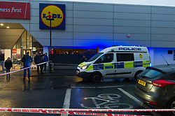 November 20, 2018 - London, London, United Kingdom - Romford Lidl stabbing...A police cordon can be seen around the crime scene. ..A man has been stabbed outside a Lidl in Romford..Police said officers were called at 13:19hrs to reports of a 19-year-old male knifed at the supermarket in Atlanta Boulevard...Officers, LAS and London's Air Ambulance attended the scene and the teen was found with stab injuries. He has been taken to a east London hospital and his condition is not known. (Credit Image: © Gustavo Valiente/i-Images via ZUMA Press)