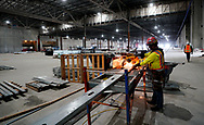 A worker cuts a metal stud in the convention center part of the Gaylord Rockies Resort & Convention Center under construction outside Denver, Colorado U.S. November 3, 2017.  REUTERS/Rick Wilking