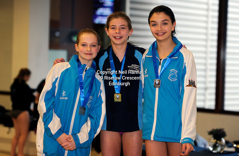 Scottish National Diving Championships & Thistle Trophy 2015<br /> Royal Commonwealth Pool, Edinburgh<br /> <br /> Girls 12-13 Years<br /> <br /> Rose Daly and Ellen Beattie of Edinburgh Diving Club  flank winner Clara Kerr of ASV Aquatics Club<br /> <br />  Neil Hanna Photography<br /> www.neilhannaphotography.co.uk<br /> 07702 246823