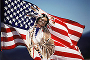 Indian on an American flag at the Saturday morning flea market in Santa Fe, New Mexico, USA.