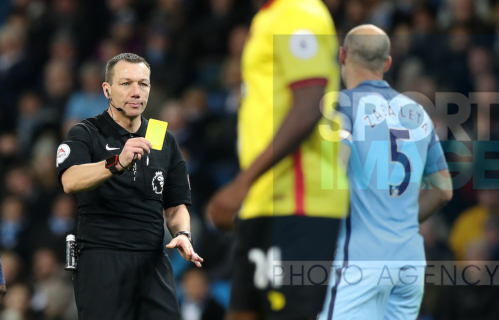 Pablo Zabaleta of Manchester City is booked during the English Premier League match at The Etihad Stadium, Manchester. Picture date: December 12th, 2016. Photo credit should read: Lynne Cameron/Sportimage