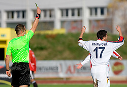 Referee Andrej Znidarsic punsihd player Arnel Mahmutovic of Rudar with a yellow card at football match of Round 17 of Slovenian first league between NK Interblock and NK Rudar Velenje,  on November 7, 2009, in ZAK, Ljubljana, Slovenia.  Interblock won 3:1. (Photo by Vid Ponikvar / Sportida)