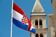 Croatian national flag, Supetar harbour, Brac island, Croatia .<br /> <br /> Visit our CROATIA HISTORIC SITES PHOTO COLLECTIONS for more photos to download or buy as wall art prints https://funkystock.photoshelter.com/gallery-collection/Pictures-Images-of-Croatia-Photos-of-Croatian-Historic-Landmark-Sites/C0000cY_V8uDo_ls